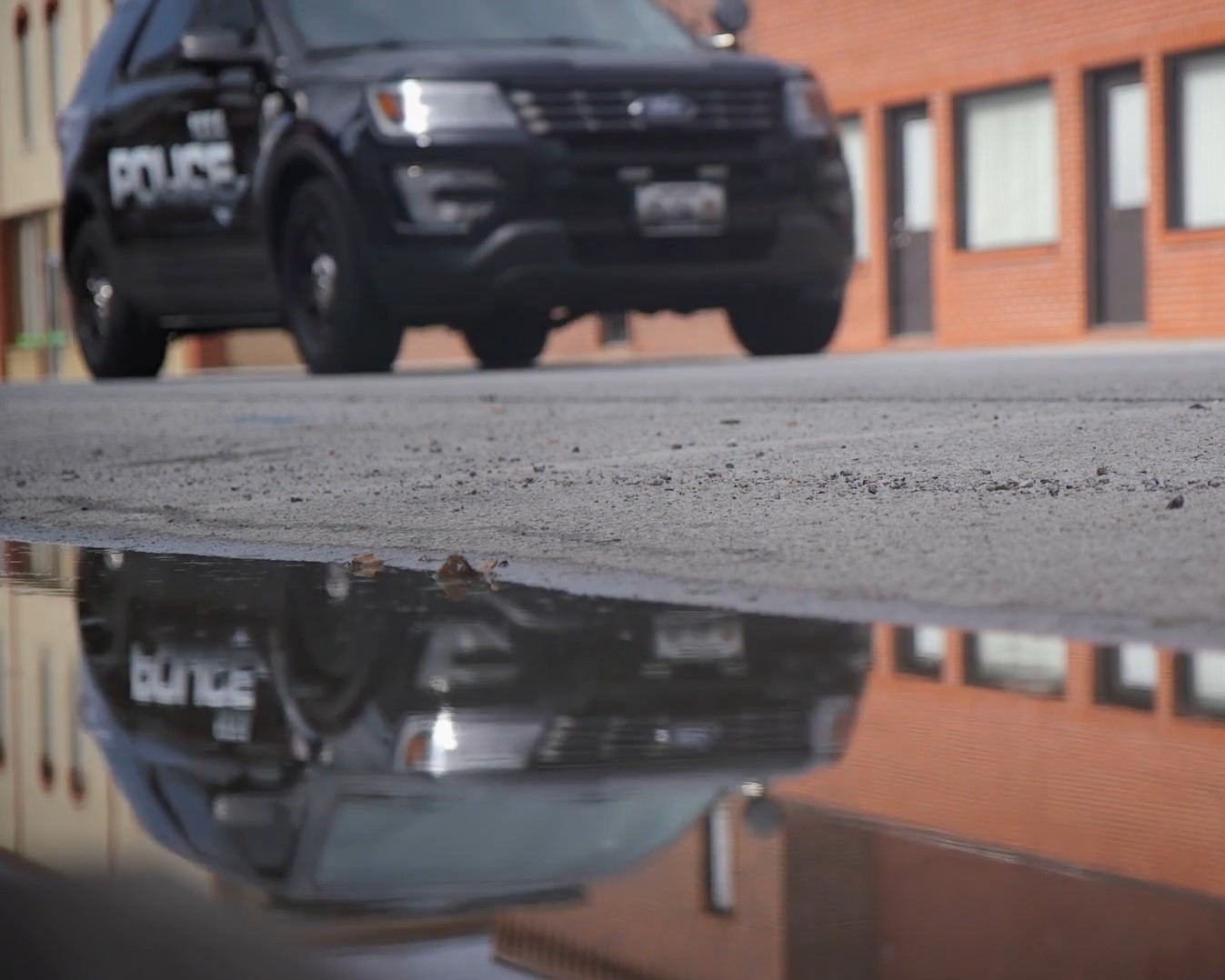 REFLECTION OF A PATROL CAR