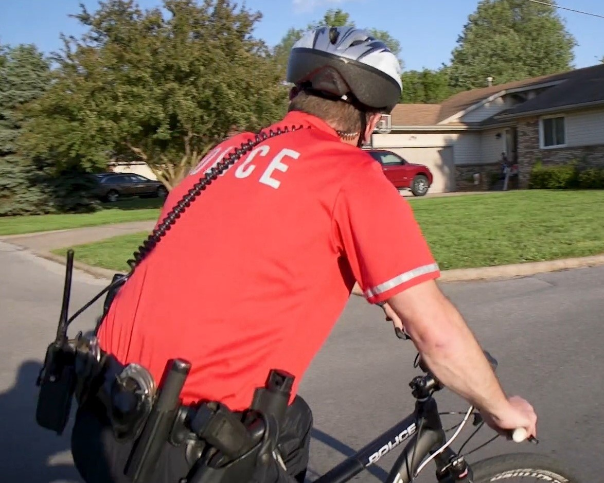 BICYCLE PATROL IN NEIGHBORHOOD