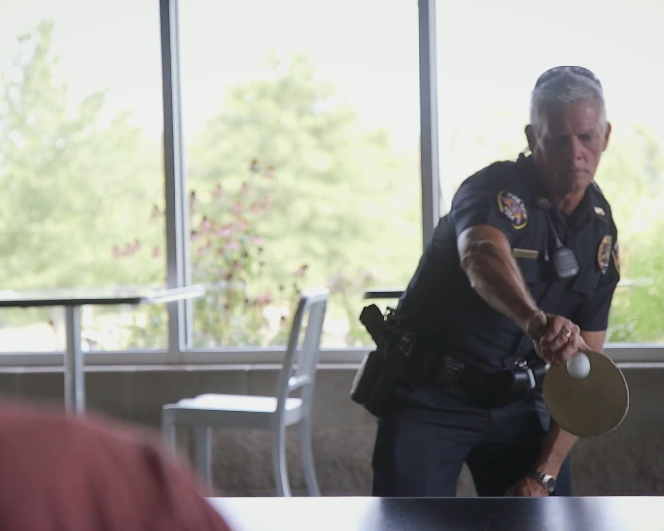 OFFICER PLAYING PING PONG